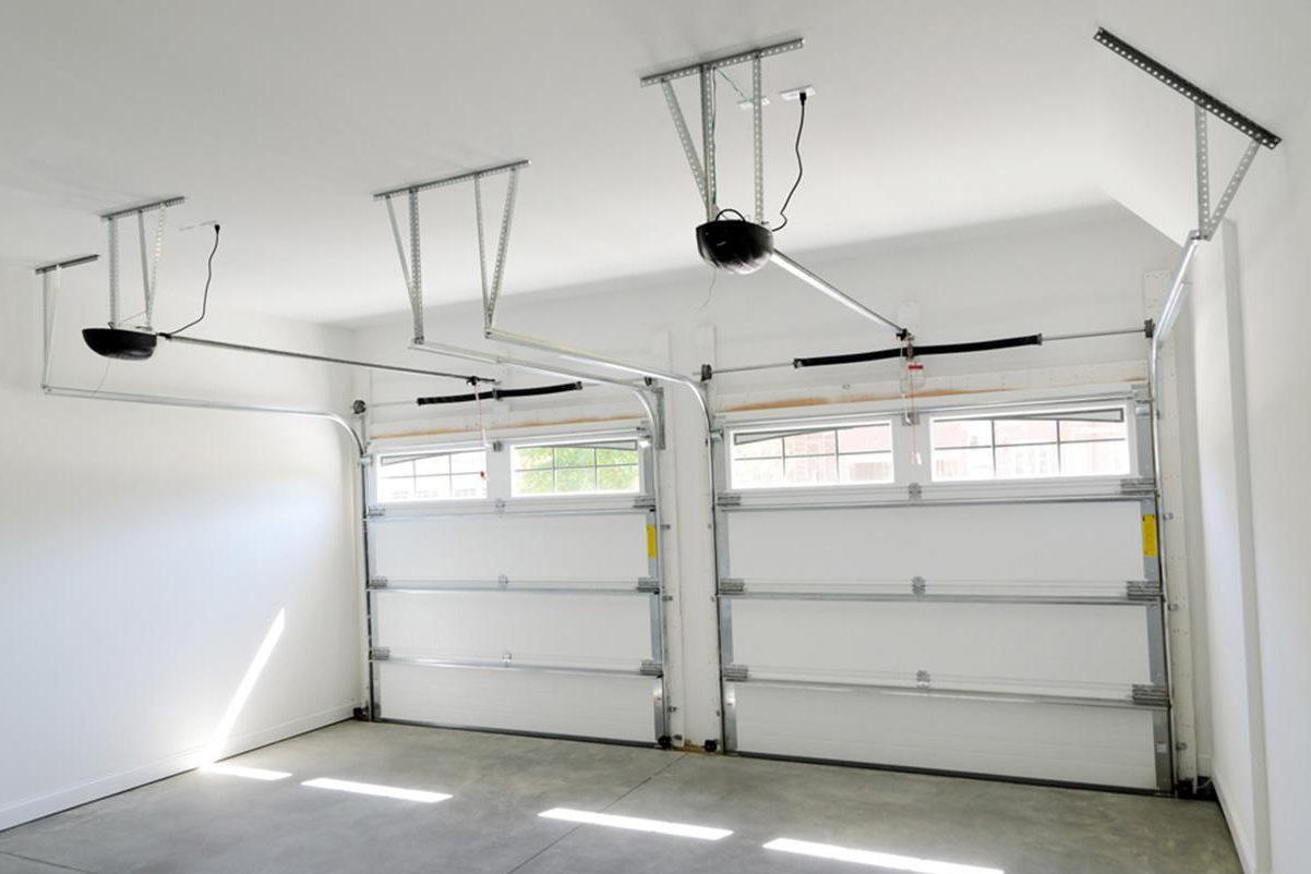 "فروش و نصب و تعمیردرب پارکینگی سکشنال ""جکوار"""